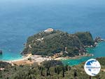 View Paleokastritsa - Op the top of the berg the klooster - Photo GreeceGuide.co.uk